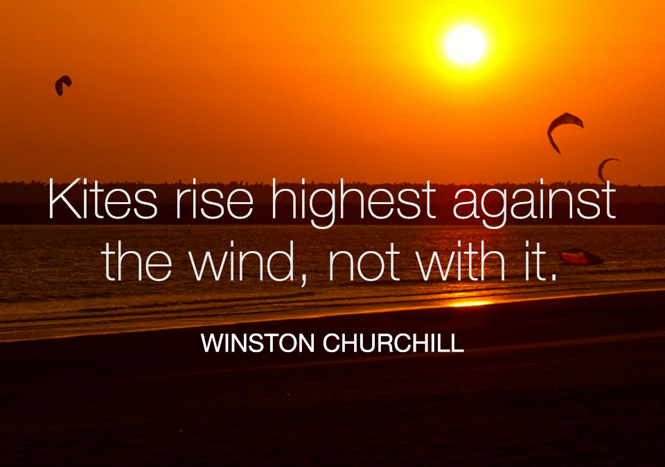 Kites rise highest against the wind, not with it